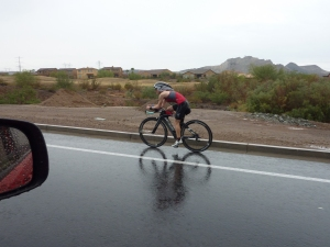 Looking strong on the bike, in the rain....